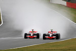 Lewis Hamilton, McLaren Mercedes overtakes Heikki Kovalainen, McLaren Mercedes