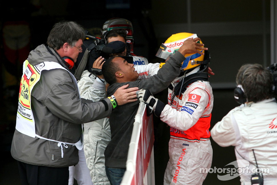 Race winner Lewis Hamilton celebrates with his brother