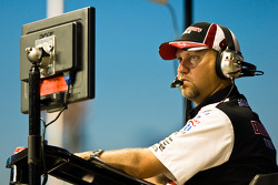 Crew chief Mike Kelly watches the race