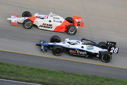 Marco Andretti and Ryan Briscoe on the lap before the accident