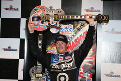 Victory lane: Scott Dixon raises his guitar triumphantly