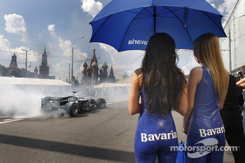 The charming Bavaria girls look on as Nico Rosberg starts