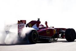 Kimi Raikkonen, Ferrari  performs a donut