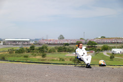 Fernando Alonso, McLaren watches qualifying from a chair at the side of the circuit after stopping without setting a time