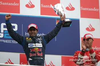 Karun Chandhok celebrates his victory on the podium with Bruno Senna