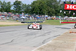 Ryan Briscoe takes the checkered flag