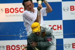 Podium: race winner Bernd Schneider gets a champagne shower