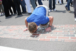 Honorary Starter, actor John McGinley of Scrubs, kisses the bricks prior to the start