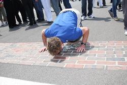 Honorary Starter, actor John McGinley of Scrubs, kisses the bricks prior to the start