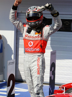 Race winner Heikki Kovalainen celebrates
