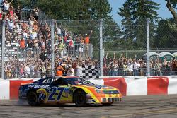 Race winner Andrew Ranger celebrates in front of an overjoyed crowd