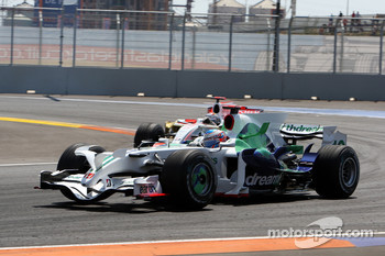 Jenson Button, Honda Racing F1 Team, RA108 leads Adrian Sutil, Force India F1 Team, VJM-01