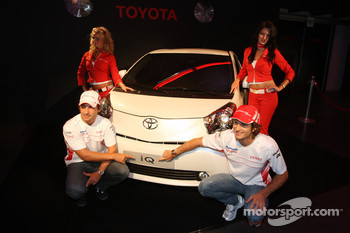 Jarno Trulli, Toyota Racing and Timo Glock, Toyota F1 Team with a Toyota IQ