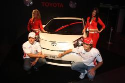Jarno Trulli, Toyota Racing and Timo Glock, Toyota F1 Team with a Toyota IQ