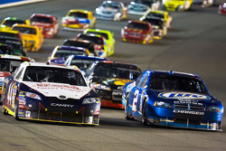 David Reutimann and Kurt Busch lead the field on a restart
