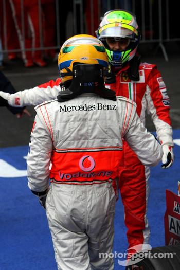 Race winner Lewis Hamilton celebrates with second place Felipe Massa