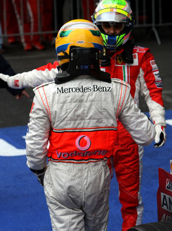Race winner Lewis Hamilton celebrates with second place Felipe Massa