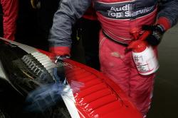 Audi Sport Team Joest team members clean up the cars