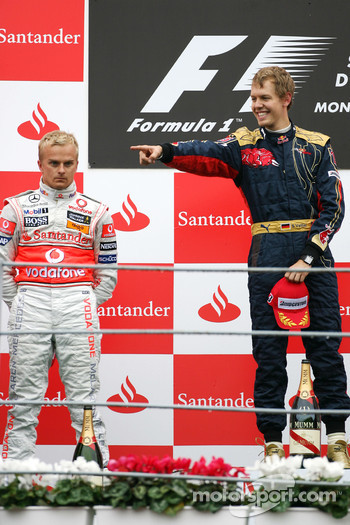 Podium: race winner Sebastian Vettel, second place Heikki Kovalainen
