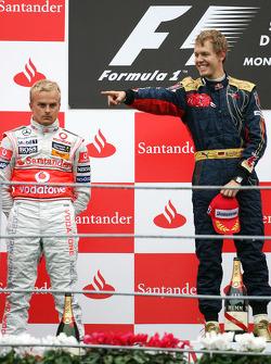 Podium: race winner Sebastian Vettel, second place Heikki Kovalainen