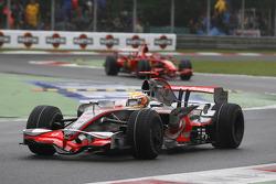 Lewis Hamilton, McLaren Mercedes, MP4-23 and Kimi Raikkonen, Scuderia Ferrari, F2008