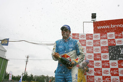 GT1 podium: Karl Wendlinger celebrates with champagne