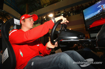 Kimi Raikkonen of Ferrari drives a F1 Simulator at Marina Mall