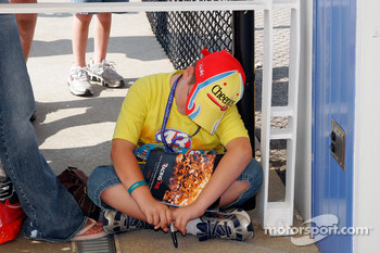 A Bobby Labonte fan try to wait for his driver to come over and sign an autograph