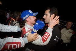 Race winner Allan McNish celebrates with Dario Franchitti