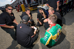 Scott Riggs discusses with crew chief Bootie Barker and his crew
