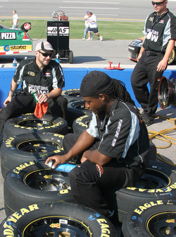 Furniture Row Chevy crew members prepare wheels