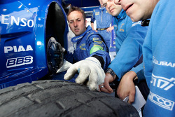 Technicians and engineers check the tyres from Petter Solberg's Subaru Impreza WRC2008