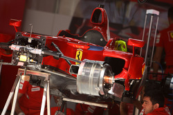 Mechanics work on the car of Kimi Raikkonen, Scuderia Ferrari