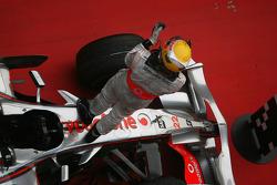 Race winner Lewis Hamilton celebates