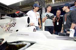 Stock Car driver Carlos Bueno, David Coulthard and Stock Car driver Daniel Serra in the Red Bull Racing garage