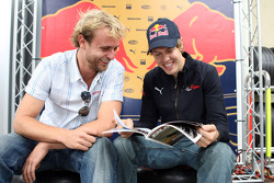 Christoph Rietner and Sebastian Vettel with the Red Bulletin