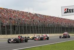Sebastian Vettel, Scuderia Toro Rosso, STR03, Heikki Kovalainen, McLaren Mercedes, MP4-23 and Fernando Alonso, Renault F1 Team, R28