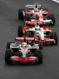 Lewis Hamilton, McLaren Mercedes, MP4-23 leads Giancarlo Fisichella, Force India F1 Team