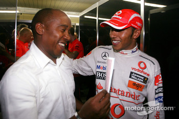 2008 World Champion Lewis Hamilton celebrates with his father Anthony Hamilton
