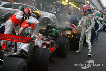 2008 World Champion Lewis Hamilton celebrates with Heikki Kovalainen and Jenson Button