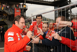 Stefano Domenicali signs autographs