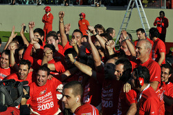 Scuderia Ferrari team members celebrate