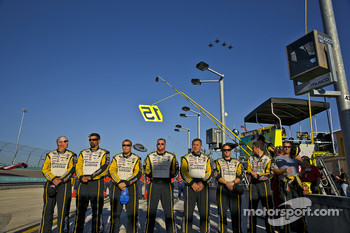 The Menards Crew stand for the National Anthem as the F-16 Eagles perform a flyover