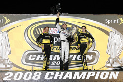 Championship victory lane: 2008 NASCAR Sprint Cup Series champion Jimmie Johnson with the lovely Sprint girls