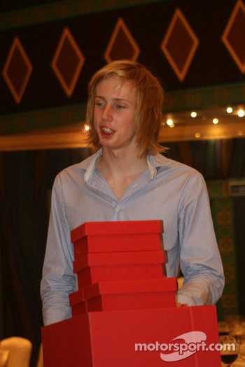 Brendon Hartley with a pile of prizes and presents