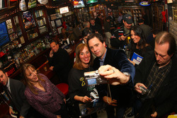 NASCAR Sprint Cup Series champion Jimmie Johnson plays photographer with a fan at Foley's