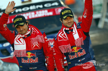 Podium: rally winners Sébastien Loeb and Daniel Elena celebrate win