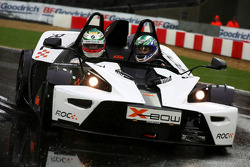 Troy Bayliss drives Andy Priaulx around the track in a KTM X-Bow