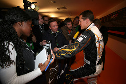 Michael Schumacher talks to the media