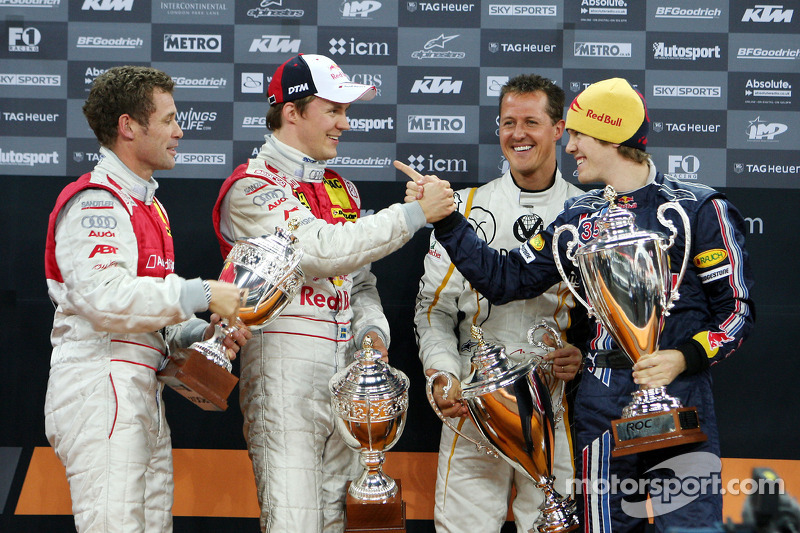 Podium: Nations Cup winners Michael Schumacher and Sebastian Vettel (Team Germany) celebrate with second place Mattias Ekström and Tom Kristensen (Team Scandinavia)